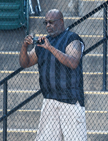 The father of Enid Majors' E.J. Taylor,           Taylor, videos an at bat against the OKC Broncos Wednesday June 28, 2017 at David Allen Memorial Ballpark. (Billy Hefton / Enid News & Eagle)