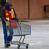 Jonathon Mollica pushes a shopping cart across the Jumbo's East parking lot Thursday January 5, 2017. As of 3 p.m. the Oklahoma Mesonet site at Breckinridge had recorded a high temperature of 26 degrees and a maximum wind gust of 28 mph. (Billy Hefton / Enid News & Eagle)