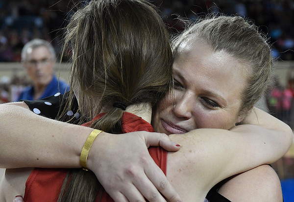Kremlin-Hillsdale coach Tanna Gragg hugs Rebecca Wasson following a 53-46 win over Lomega in the class B state championship game Saturday March 4, 2017 at the State Fair Arena in Oklahoma City. (Billy Hefton / Enid News & Eagle)