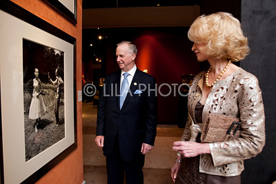 Nancy and Walter Raquet admiring Fred Astaire and Audrey Hepburn Photo in Mallett Gallery