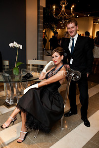 Sandra Cameron with furniture designer Marc Ross (chair she is sitting on designed by Marc Ross).
