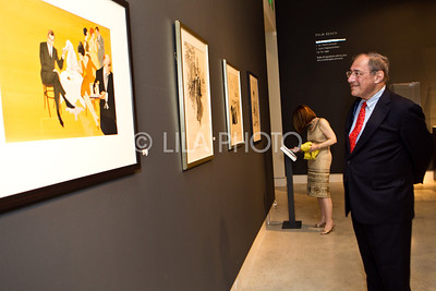 Fred Scharf admiring pieces from his own collection.  Image in foreground signature print for Cocktail Culture
