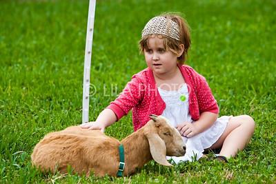 Hazel Cummins (5) Petting Goat;photography by: LILA PHOTO