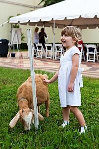 Sophia Angle (3) petting goat ;photography by: LILA PHOTO