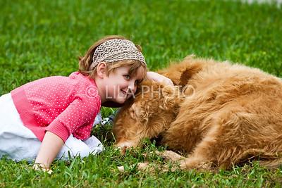 Hazel Cummins (5) Petting Cow; photography by: LILA PHOTO