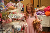 Ella Baker, 7, shops for a pair of shoes for her doll at the Girls and Dolls event at the Crowne Plaza Ravinia on Sunday, Dec. 6, 2009.  Nails, hair, doll day care, photos, shopping and fashion show.  Sponsors include Gap, Davis Academy, Vibe, Balance hair studio.
