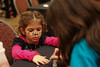 JCC volunteer Ashley Siegel, 12, paints 3-year-old Kate Guiness' nails at the Girls and Dolls event at the Crowne Plaza Ravinia on Sunday, Dec. 6, 2009.  Nails, hair, doll day care, photos, shopping and fashion show.  Sponsors include Gap, Davis Academy, Vibe, Balance hair  studio.