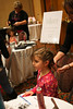 Anna Wohlberg, 6, has her hair braided thanks to Balance in Dunwoody at the Girls and Dolls event at the Crowne Plaza Ravinia on Sunday, Dec. 6, 2009.  Nails, hair, doll day care, photos, shopping and fashion show.  Sponsors include Gap, Davis Academy, Vibe, Balance hair  studio.
