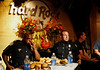 Hard Rock Cafe Atlanta celebrates its 1971 founding by providing Legendary Burger to Atlanta public servants for 71 cents on Saturday, June 14, 2008.  This year, police officers and fire fighters participated in a Legendary Burger Guns 'n' Hoses eating competition winning proceeds to charity.  Atlanta Police Sergent Adam Lee, left, works on finishing his final burger as officer Mike Monheim, second from left, waits for the results.  Firefighters finished more of the 71 mini burgers than did the police officers and won proceed from a summer-long John Legend signed guitar raffle for the Gold Shield Foundation.  (Hard Rock Cafe Atlanta/ AP Photo / Jenni Girtman)