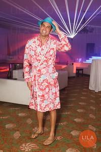 Richard Gaff (wearing a men's Lilly bathrobe)