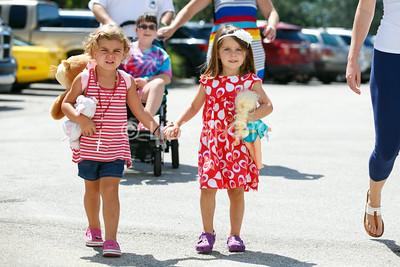 Twins Sawyer, left, and Savanna, 3, attend the Summer Gardens GreenMarket at STORE Sunday.