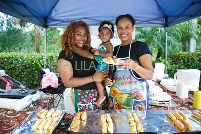 Leslie, Nilah, 1, and Marie Sterling, at the Sweet Marie's Chicken and Waffles in the Summer Gardens GreenMarket at STORE Sunday.