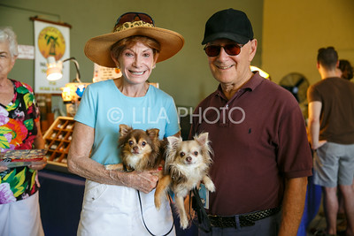 Gail and Jay Koslow with their dogs Sylvie and Gina, enjoy the Summer Gardens GreenMarket at STORE Sunday.