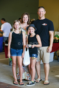 Brian and Becky Shifflett with their daughters Kayla, 11, and Lauren, 10, enjoy the Summer Gardens GreenMarket at STORE Sunday.