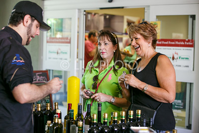 Kelly Owen, left, and Merrill Hughes enjoy some samples during the Summer Gardens GreenMarket at STORE Sunday.