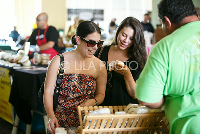 Amanda, left, and Melissa Zam look at soaps at the Summer Gardens GreenMarket at STORE Sunday.
