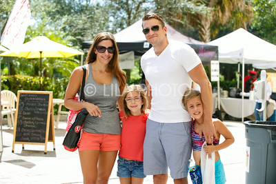 Adam and Annie Hall with their kids Evelyn, 8, and Josie, 8, enjoy the Summer Gardens GreenMarket at STORE Sunday.