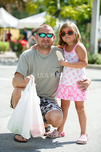 Jim Mohl and his daughter Kai, 5 enjoy the Summer Gardens GreenMarket at STORE.