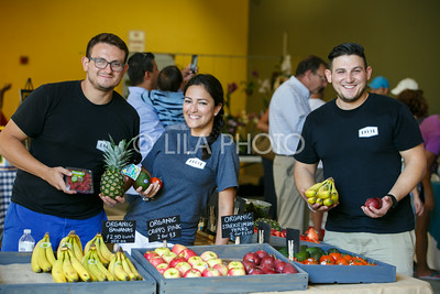 Felipe, Christina, and Alex Celis, with show off their selection at the Celis Produce stand at the Summer Gardens GreenMarket at STORE Sunday.