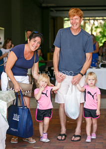 Michele and Norman Roeloffs and their twins Samantha, left, and Katherine enjoy the Summer Gardens GreenMarket at STORE Sunday.
