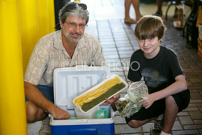 Mike Renda and his son Aidan, 16, enjoy the Summer Gardens GreenMarket at STORE Sunday.