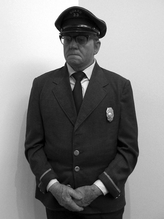 "I was wondering why this guard was staring at me for so long and I went over to Becky<br /> and started to say something about the guard just staring at me and Becky said ""You know he's not real don't you?""<br /> The Museum Guard, 1975 by Duane Hanson."