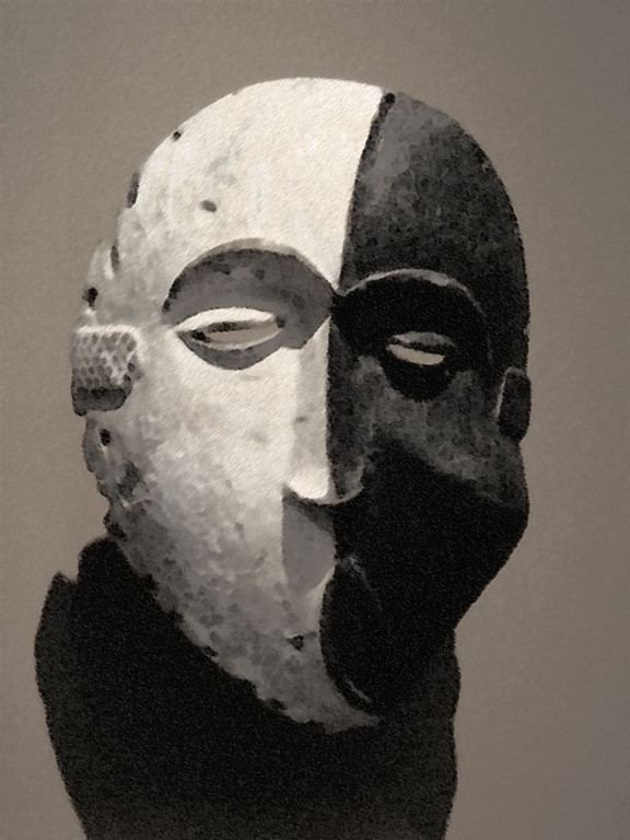 This African mask is in a dimly lit gallery with other art from Africa.<br /> The photo wasn't as sharp as I had wanted, so I photo shopped it a bit.