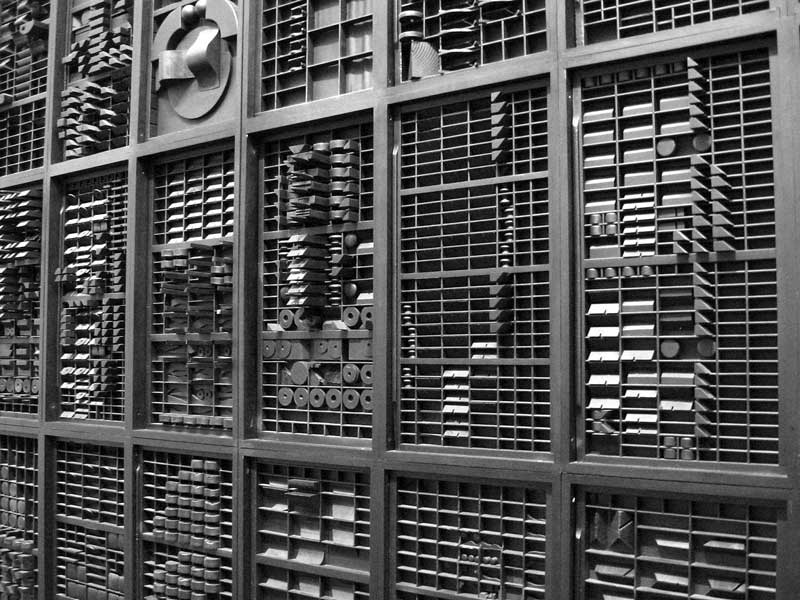 A wall sculpture made from printer's drawers.<br /> End of Day-Nightscape IV, 1973 by Louise Nevelson.