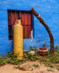 Gas Cylinder and Blue Wall