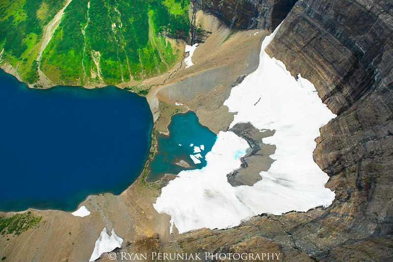 The remnants of what was once a glacier. Beautiful as they melt; disconcerting to envision them gone. <br /> <br />  Sadly the glaciers that remain in Glacier National Park (Montana) are in their final few decades of existence.