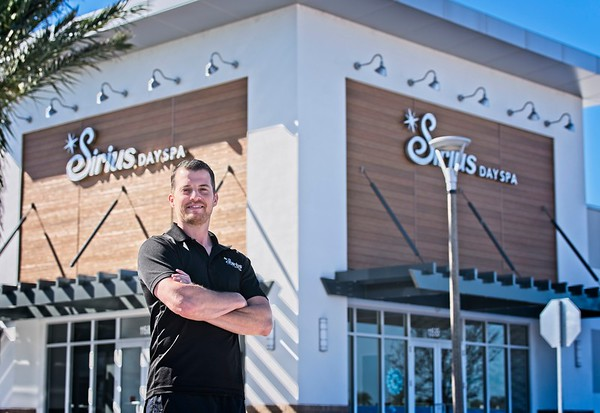 Hometown News - Sirius Day Spa - Gustavo Noguerra LMT doing sports massage