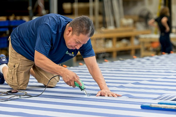 Hometown News - Sun Protection of Florida - MArcos Campa (awning fabricator) Sewing and cutting a canopy