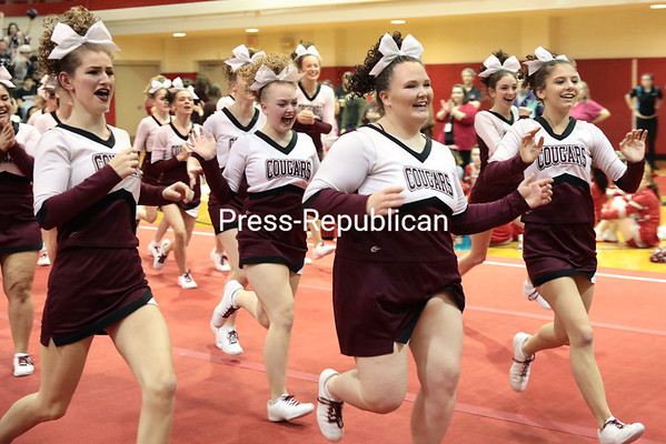 GABE DICKENS/ P-R PHOTO<br /> The Northeastern Clinton cheerleading squad races across the gymnasium floor at Beekmantown High School Thursday to collect its trophy for winning the Champlain Valley Athletic Conference cheerleading competition. Also taking home honors were Northern Adirondack for the best co-ed cheerleading squad and the Cougars for the best small school in the competition. This is the Cougars'<br /> 10th consecutive sectional win.
