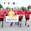 GABE DICKENS/ P-R PHOTO<br /> More than 70 members of numerous law enforcement agencies across the North Country jog down Route 3 in the Town of Plattsburgh during Friday's Plattsburgh Law Enforcement Torch Run for the New York Special Olympics.