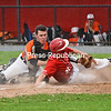 KAYLA BREEN/ STAFF PHOTO<br /> Saranac's Logan Matthews slides into home as Plattsburgh High's Liam Rascoe attempts to tag Matthews out.