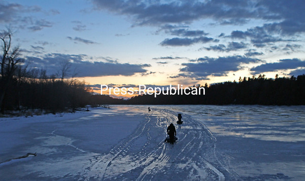 MIKE PITTS/ P-R PHOTO<br /> Local anglers braved the cold Wednesday at Deep Bay at Point Au Roche State Park. Water temperatures so far this year have stayed at consistently freezing levels in the bay.