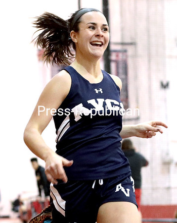 GABE DICKENS/ P-R PHOTO<br /> AuSable Valley's Brin Peck is all smiles after handily winning the girls 300-meter dash.