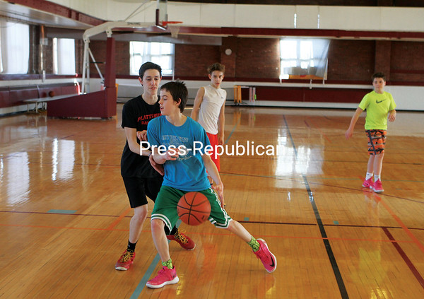 MIKE PITTS/ P-R PHOTO<br /> Kalinowski brothers (from left) Jared, 17; Jaden, 14; and Samuel, 14; of Plattsburgh battle it out in a game of pickup basketball with friend Riley Channell, 14, of Plattsburgh at the Plattsburgh City Gym. The facility was a busy place during winter break from school for kids around the region.