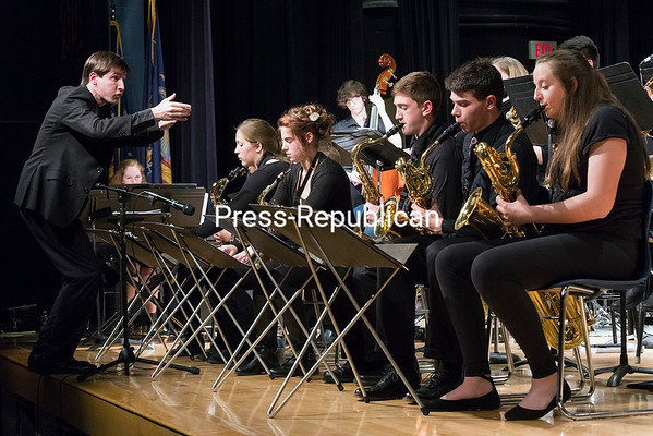 """GABE DICKENS/ P-R PHOTO<br /> Plattsburgh City School District Jazz Program Director Patrick Towey conducts the Plattsburgh High School Jazz Ensemble during the piece """"How High the Moon"""" by Morgan Lewis during the Spring Jazz Concert in the Stafford Middle School Auditorium recently. The evening also featured performances by the Stafford Middle School Jazz Ensemble and the Middle School and High School Jazz Combo."""