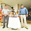 KAYLA BREEN/ STAFF PHOTO<br /> Marine Corps veteran John Mashtare (left) and Army veteran Dave Gordon stand next to the ceremonial table holding the POW, MIA and Armed Forces memorial candles during the Peru Memorial Day Services held at Veterans of Foreign Wars Post 309.