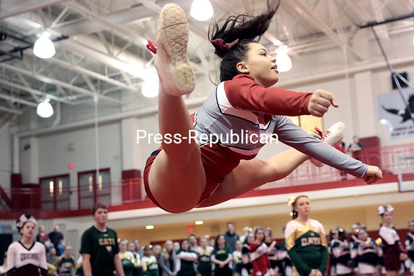GABE DICKENS/ P-R PHOTO<br /> Beekmantown cheerleader Nycia Towle wins the high jump competition with a series of three jumps.