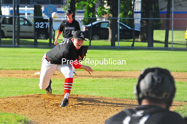 KAYLA BREEN/ STAFF PHOTO<br /> Fourth Ward Cardinals pitcher Ryan Whalen delivers a pitch during Tuesday night's Champlain Valley Baseball League game against the Fourth Ward A's at Lefty Wilson Field in Plattsburgh.