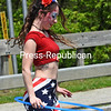 KAYLA BREEN/ STAFF PHOTO<br /> Clad in red, white and blue, Emily Gandalfo entertains parade watchers with a hula-hoop performance.