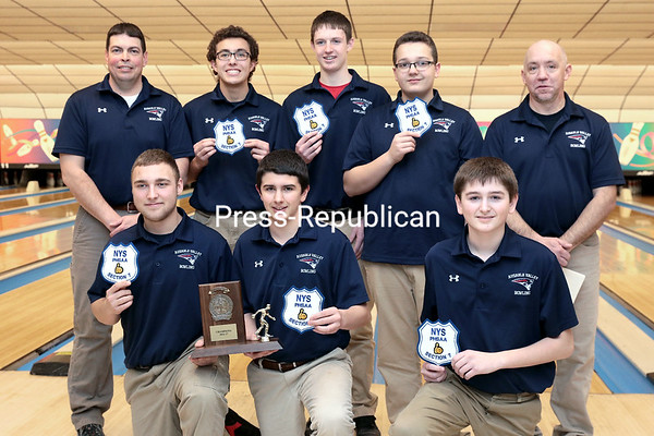 GABE DICKENS/ P-R PHOTO<br /> The AuSable Valley boys bowling team poses with the Section VII championship trophy Saturday at North Bowl Lanes in Plattsburgh.