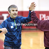 GABE DICKENS/ P-R PHOTO<br /> John Piestrzynski receives a high five from a teammate during a basketball tournament.