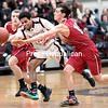 GABE DICKENS/ P-R PHOTO<br /> Saranac's Tyler Blair (left) and Logan Matthews (right) battle with Northeastern Clinton's Michael McLeod (center) for control of the ball during Thursday's Champlain Valley Athletic Conference boys basketball game at Northeastern Clinton Central School.