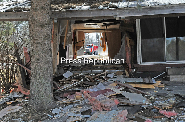 JOANNE KENNEDY/ P-R PHOTO<br /> A vehicle barreled through this home owned by Adirondack Farms at 280 River Road in Peru on Monday morning. The driver suffered a severe cut to her head and other injuries. No further information was available Monday.
