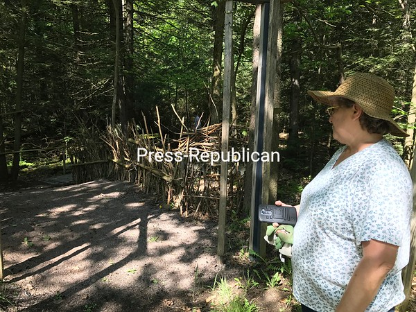 DENISE RAYMO/ STAFF PHOTO<br /> Gina Strachan shows where the Fairy and Troll Festival will take place in the woods at Sellars Field in Burke. The event, which includes a costume contest, is set for 10 a.m. to 6 p.m. this Saturday.
