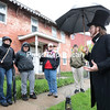 GABE DICKENS/ P-R PHOTO<br /> Champlain Valley Educational Services students under the supervision of art teacher Meredith Jacobs and physical education teacher Kim Mayer receive a brief history lesson on the brick building at 44 Pike Street in the City of Plattsburgh from a costumed Matt Boire of the Greater Adirondack Ghost and Tour Company. It was once home to Benjamin Mooers, a lieutenant in the American Revolutionary War and major general of volunteers in the War of 1812. The history-tour and art-walk field trip gave students a way to combine physical education and art, as they were invited to display their work at local businesses by the First Weekends Committee through May.