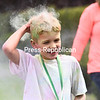 KAYLA BREEN/ STAFF PHOTOS<br /> Jacob Haley, 7, wipes the colored powder from his hair after completing the children's 10 and younger 1-mile Blast of Color Run at the CVPH Wellness & Fitness Center in Plattsburgh. The money raised at the event will be used by the Foundation of CVPH to benefit local families.